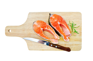 Trout on the board with a knife and rosemaryの写真素材 [FYI00652721]