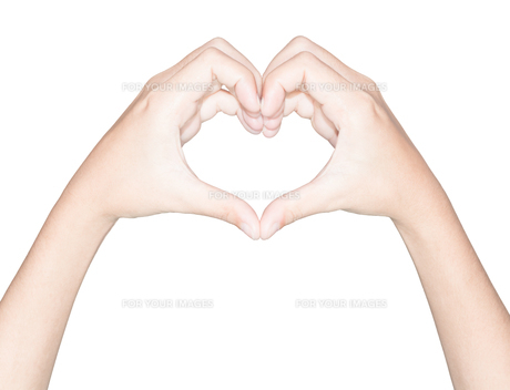 closeup hand heart love symbol isolated white clipping path insideの素材 [FYI00652737]