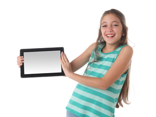 Beautiful pre-teen girl laughing with a tablet computerの写真素材 [FYI00652947]