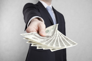 Businessman with american dollars. Clipping path included.の写真素材 [FYI00652970]
