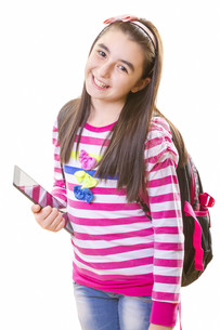 Beautiful teenager girl with backpack and digital tabletの写真素材 [FYI00653169]