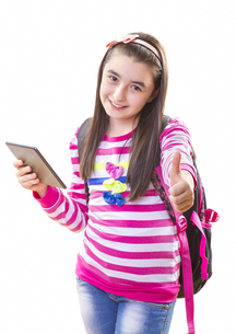 Beautiful teenager girl with backpack and digital tabletの写真素材 [FYI00653170]