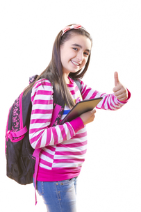 Beautiful teenager girl with backpack and digital tabletの写真素材 [FYI00653173]