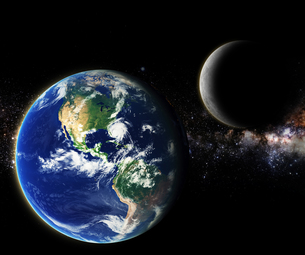 earth and moon in milky way galaxy space element finished by nasaの写真素材 [FYI00653192]