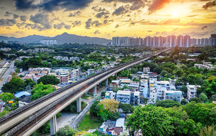 hong kong urban downtown and sunset speed trainの写真素材 [FYI00653196]