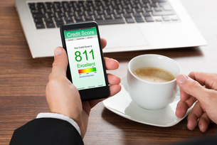 Businessman Checking Credit Score On Cellphoneの写真素材 [FYI00653424]