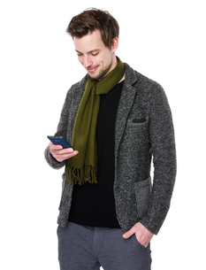 Caucasian man look at cellphoneの写真素材 [FYI00653682]