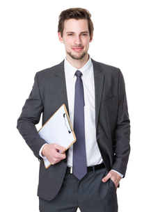 Businessman hold with clipboardの写真素材 [FYI00653713]
