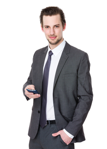 Attractive man with a mobile phoneの写真素材 [FYI00653792]