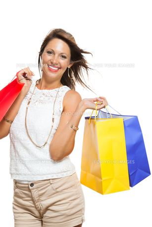 young stylish woman with colorful shopping bags schlussverkauf saleの写真素材 [FYI00653818]
