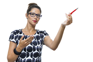 attractive businesswoman pointing with a pen to topの写真素材 [FYI00653987]