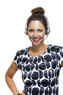 young businesswoman with headset operator telephone operator with headsetの写真素材 [FYI00653997]