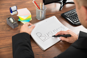 Businessman With The Text Business On Notebookの写真素材 [FYI00654089]
