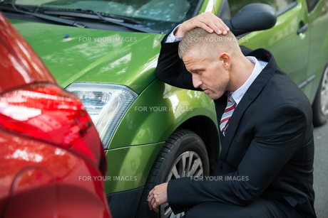 Upset Driver Looking At Car After Traffic Collisionの写真素材 [FYI00654097]