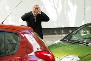 Stressed Driver Looking At Car After Traffic Collisionの写真素材 [FYI00654107]