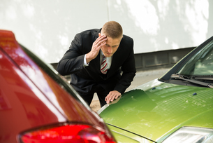 Stressed Driver Looking At Car After Traffic Collisionの写真素材 [FYI00654109]