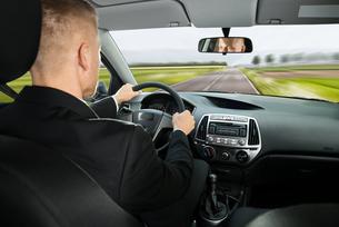 Businessman Driving Carの写真素材 [FYI00654195]