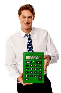 Male executive with big calculator.の写真素材 [FYI00654641]