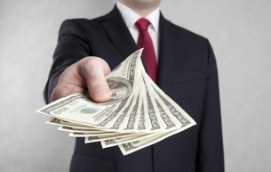 Businessman with american dollars. Clipping path included.の写真素材 [FYI00655078]