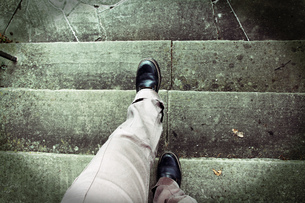 vertigo when climbing stairs. acrophobia. accident risk when climbing stairsの写真素材 [FYI00655118]