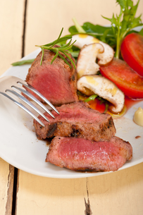 beef filet mignon grilled with vegetablesの写真素材 [FYI00655220]