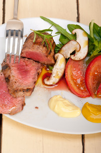 beef filet mignon grilled with vegetablesの写真素材 [FYI00655229]
