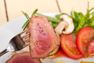 beef filet mignon grilled with vegetablesの写真素材 [FYI00655234]