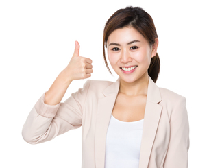 Asian businesswoman with thumb up gestureの写真素材 [FYI00656403]