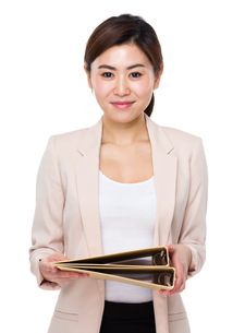 Young businesswoman hold with folderの写真素材 [FYI00656414]