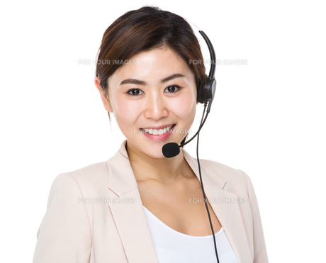 Businesswoman with headset for supporting serviesの写真素材 [FYI00656418]