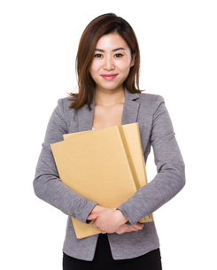 Business woman hold with folderの写真素材 [FYI00656489]