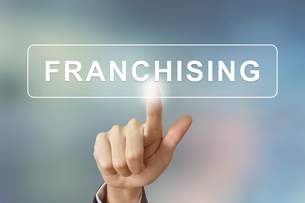 business hand clicking franchising button on blurred backgroundの写真素材 [FYI00656991]