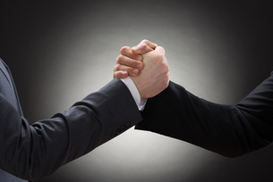 Two Businessman Arm Wrestlingの写真素材 [FYI00657164]