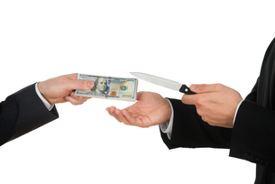 Businessman Giving Money To The Businessperson With Knifeの写真素材 [FYI00657229]