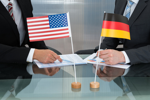Close-up Of American And German Businessmanの写真素材 [FYI00657247]