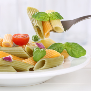italian food colorful penne rigate pasta pasta dish with forkの写真素材 [FYI00657876]