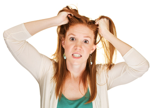 Angry Woman Pulling Her Hairの写真素材 [FYI00657972]