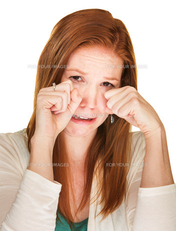 Sobbing Woman Rubbing Her Eyesの写真素材 [FYI00657983]