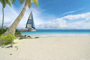 Tropical beach and sailboatの写真素材 [FYI00658840]