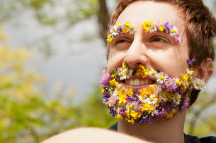 flower hipster ecofriendly man smilingの写真素材 [FYI00659204]