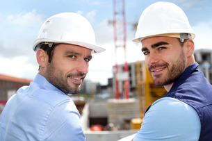 Portrait of an attractive worker and an architect on a construction siteの写真素材 [FYI00659512]