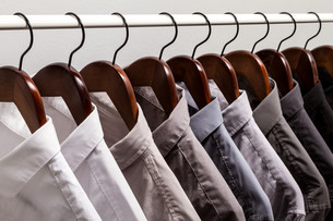 Several shirts on a hanger.の写真素材 [FYI00659862]