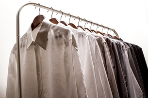 Several shirts on a hanger.の写真素材 [FYI00659867]