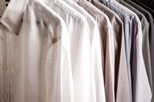 Several shirts on a hanger, background.の写真素材 [FYI00659874]