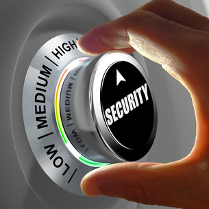 Hand rotating a button and selecting the level of security.の写真素材 [FYI00660750]