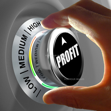 Hand rotating a button and selecting the level of profit.の写真素材 [FYI00660755]