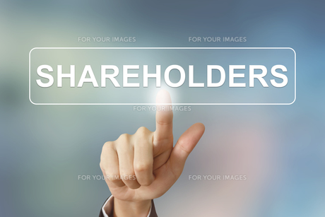 business hand clicking shareholders button on blurred backgroundの素材 [FYI00661390]