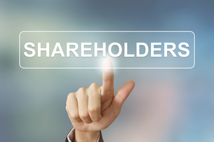 business hand clicking shareholders button on blurred backgroundの写真素材 [FYI00661390]