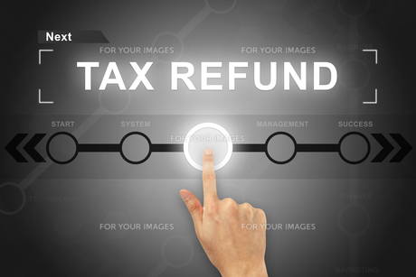hand clicking tax refund button on a screen interfaceの素材 [FYI00661393]