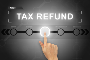hand clicking tax refund button on a screen interfaceの写真素材 [FYI00661393]